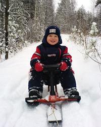 Мальчик на снегокате ?Аргамак?