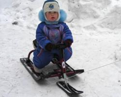 Ребенок на снегокате ?Барс?
